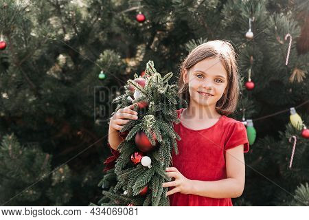 Merry Christmas. Portrait Of Happy Funny Child Girls In Santa Hat With Christmas Wreath. Happy Holid