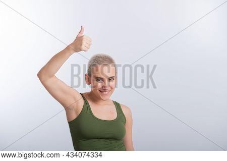 Young Caucasian Woman Holding Raised Hand White Background Smiling Girl Green Tshirt Short Blond Hai