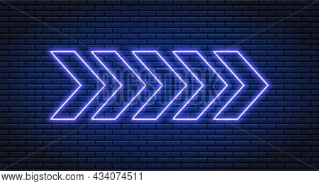 Neon Arrow Lamp Wall Sign. Glowing Neon Arrow Pointer On Brick Wall Background. Retro Signboard With