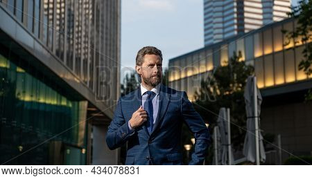 Business Success. Successful Man In Businesslike Suit. Manager Executive Outside The Office
