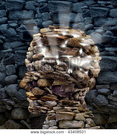 Power of thinking and free your mind as a business or health care concept with a group of rocks in the shape of a human head glowing with a bright inner light as a symbol of freedom and intelligence. poster