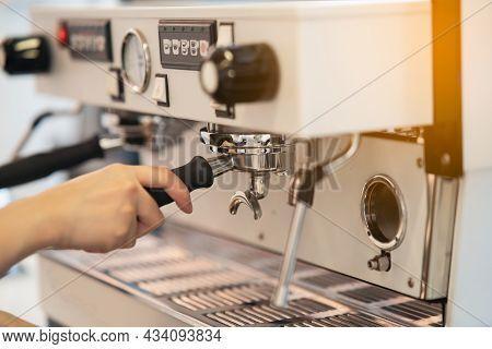 Women Barista Making Coffee In A Coffee Machine, Coffee Making Concept