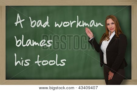 Teacher Showing A Bad Workman Blames His Tools On Blackboard