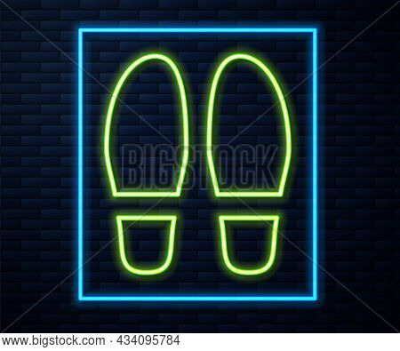 Glowing Neon Line Footsteps Icon Isolated On Brick Wall Background. Detective Is Investigating. To F