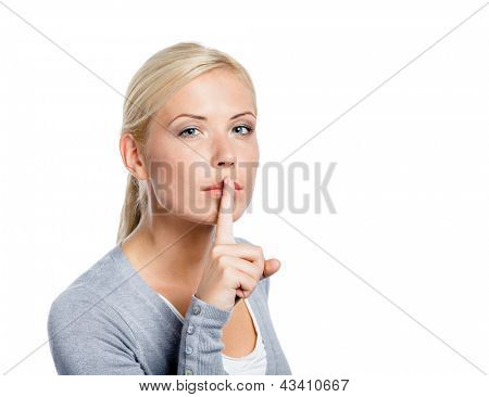 Girl making silence gesture with forefinger, isolated on white
