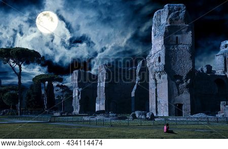 Baths Of Caracalla At Night, Rome, Italy. Spooky Ancient Ruins In Full Moon On Halloween. Scary Gloo