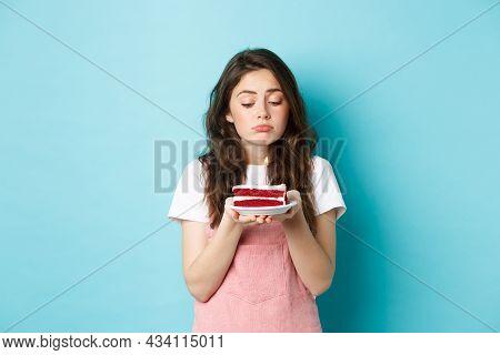 Holidays And Celebration. Sad Cute Girl Celebrating Her Birthday Alone, Holding Cake On Plate With O