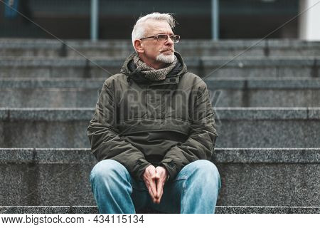 Lonely Old Man. A Gray-haired Man With Wrinkles Sits Outside, Sad. Lost A Loved One, Negative Though