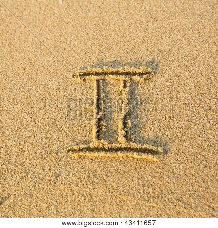 Zodiac sign Gemini, drawn on the facture beach sand. (zodiac signs series)
