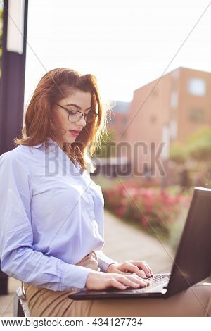 Young Caucasian Businesswoman Woman Working On Laptop In Park