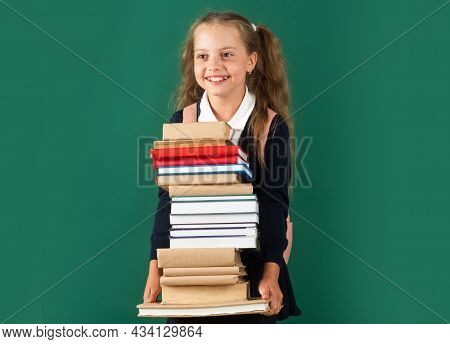 Knowledge Day, Smiling Little Schoolkid Girl With Backpack Hold Books On Blackboard. Childhood Lifes
