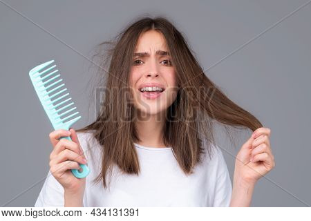 Hair Care. Straightening Woman And Treatment Of The Hair. Girl With Straight Brushed Hair. Hair Tang