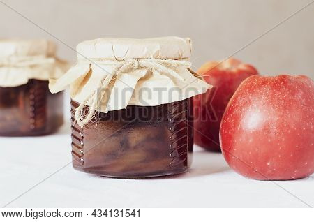 Homemade Delicious Sweet Apple Jam In A Jar, On A White Background. Tea Treat Or Pie Filling. Apple