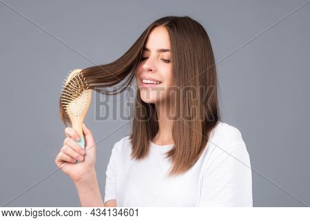 Brushing Hair. Portrait Young Smiling Woman Brushing Straight Natural Hair With Comb. Girl Combing H