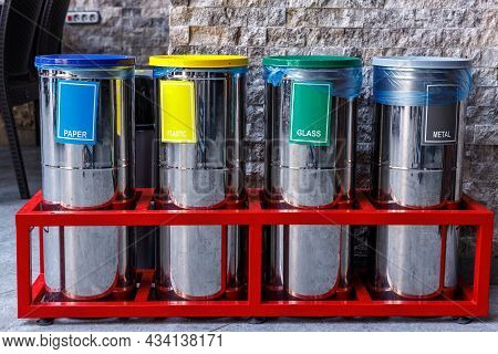 Metal Tanks With Inscriptions For Separate Garbage Collection. The Concept Of Waste Disposal.
