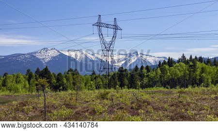 Support And Wires Of The Power Line On The Upper Swamp In The Foothills Of The Khamar-daban Ridge. M