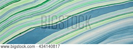 background of handmade Thai marbled mulberry paper in green and blue with flowing pattern, panoramic web banner