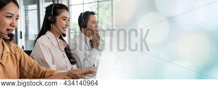 Business Team Wearing Headset Working Actively In Office . Call Center, Telemarketing, Customer Supp