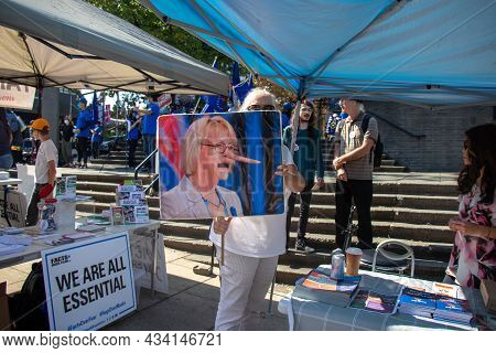 Vancouver, Canada - September 8,2021: Anti-masks Protester Is Holding A Caricature Photo Of Dr. Bonn