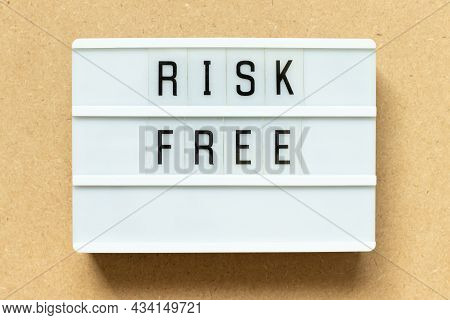 Lightbox With Word Risk Free On Wood Background