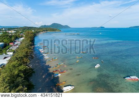 Aerial View Of Thai Traditional Longtail Fishing Boats In The Tropical Sea Beautiful Beach In Phuket