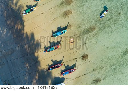 Aerial Drone Bird's Eye View Photo Top Down Of Tropical Sea With Long Tail Fishing Boats At Phuket T