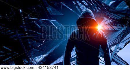 Silhouette of man in hoody