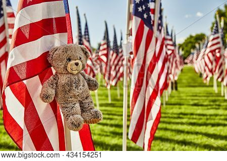 Teddy Bear Hanging On The American Flag In Honor Of 9/11 Victims