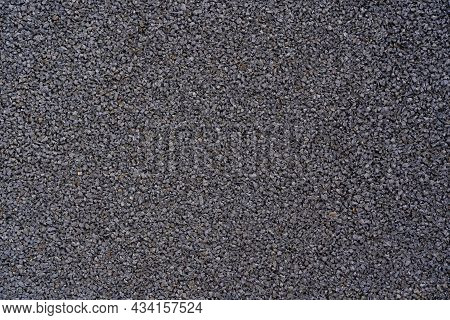 Black Rubber Coating Made Of Recycled Rubber Chips On The Sports Field.top View