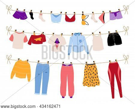 Dry Clothes. Hanging Clean Laundry. Men And Women Clothing Drying On Sun. Casual And Business Outfit