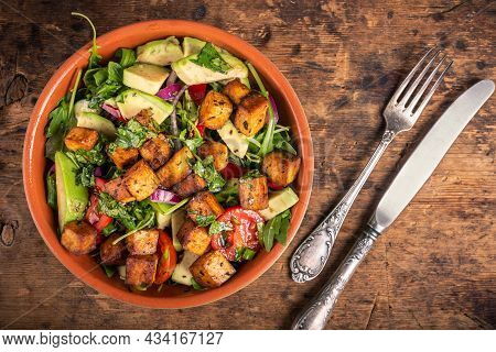 Salad With Vegetables, Tomatoes, Cucumbers, Onions, Avocado, Arugula Leaves And Fried Tofu, Top View