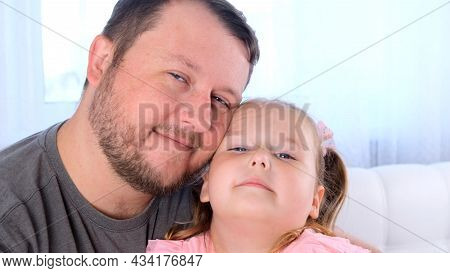 Cute Little Daughter 3 Years Old And Father Gently Hug And Have Fun At Home. Have Fun With Your Baby
