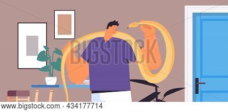 Man Holding Yellow Python Snake Guy Having Dangerous Reptile Pet Living Room Interior Horizontal