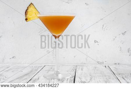Glass Of Bahamas Daiquiri Garnished With Pineapple Wedge