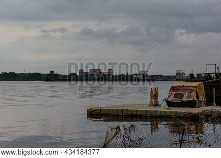 Boat At The Pier. Rybinsk Gateway And Rybinsk Hydroelectric Power Station In The Background. River V