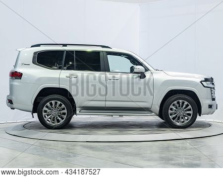 Novosibirsk, Russia - September    24 , 2021: White Toyota Land Cruiser 300, Side View. Photography