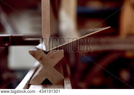 The Process Of Bending Metal Parts On A Modern Bending Machine. Long Metal Parts Made Of Thin Galvan