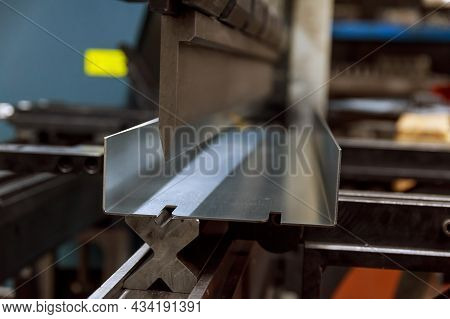 Working With Sheet Metal And Special Bending Machines. Hydraulic Press Brake Or Bending Machine For