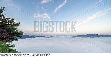 A Stunning Panorama Of Nature, Fog Spread Over The Hills And Mountains. Morning Fog In The Mountains