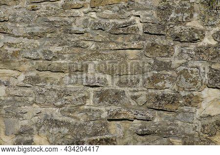 Asphalt Or Bitumen Raw Materials For Road Construction. Gray Asphalt Texture. A Whole Dry Roadbed. A