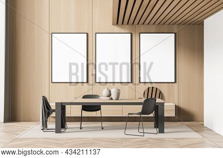 Three Empty Canvases In The Wooden Living Room With A Dining Table And A Wall Mounted Sideboard. Par