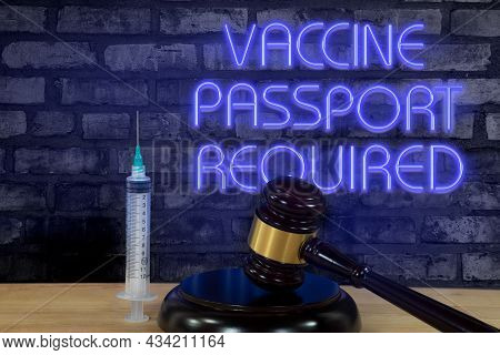 Wooden Court Gavel And A Vaccination Shot With Glowing Purple Neon Sign On Brick Wall