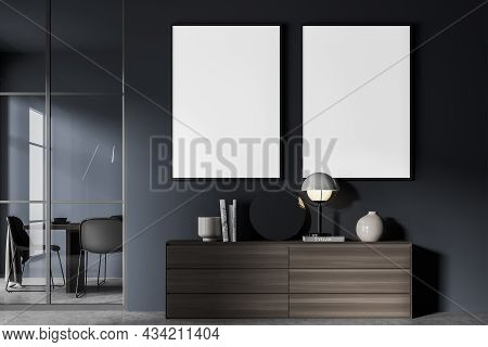 Two Canvases In The Blue Living Room Interior With A Dark Wood Sideboard. A Dining Room Behind A Fra