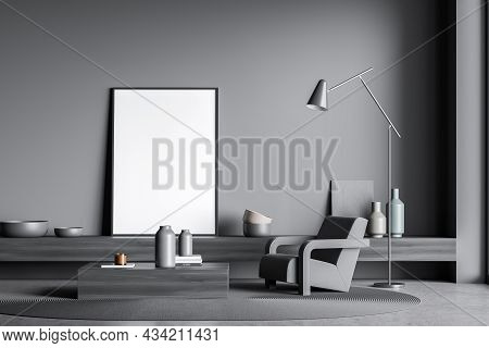Empty Standing Canvas On Dark Grey Wall Of Minimalist Living Room Interior With A Coffee Table, An O
