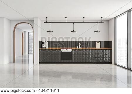 White Interior With A Stylish Black Kitchen With Simplified Cabinets And Frame With Three Lamps, A G