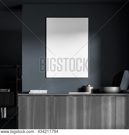 View Of An Empty White Frame On The Blue Wall Over A Dark Wood Sideboard In The Living Room Area. Mo