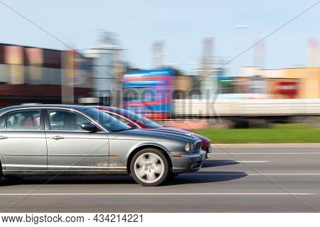 Cars Drive At High Speeds On The Street Without Observing The Permitted Speed. Speeding In The City.