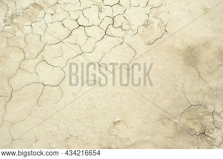 Beige Background. The Land Is Cracked From Drought. Drought. Copy Space. Background For Presentation