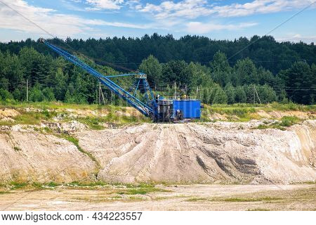 Mining Excavator Works In The Chalk Quarry. Heavy Mining Industry And Equipment For Working In Open
