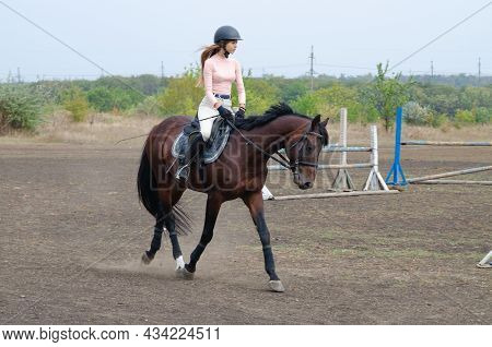 Donetsk, Ukraine-19.09.2021: Training Of A Jockey And A Horse On The Street. A Horse With A Rider Ju